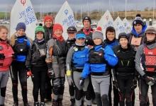 Optimist sailors and coaches