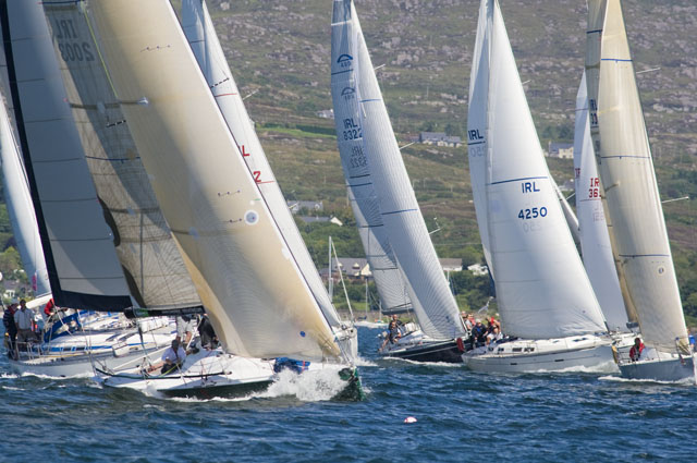Yachts racing under blue skies with Mount Gabriel in the background during Calves week 2012. Picture Robert Bateman