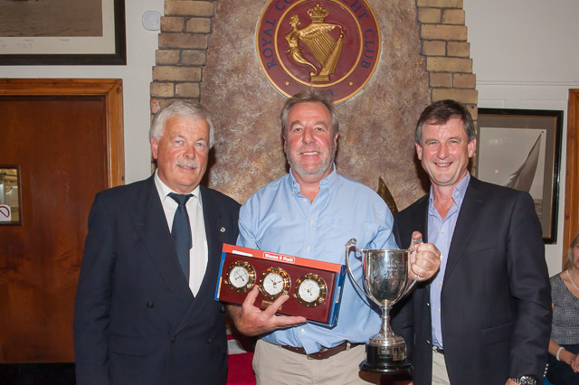 Popular Class Two winner in both IRC and ECHO Shane Statham of WHSC With Admiral Peter Deasy and Sponsor Nick Bendon of CH Marine. Picture Robert Bateman