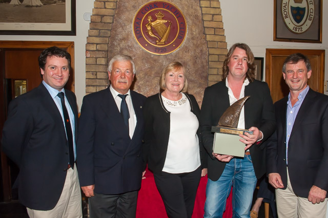 Rob McConnell, Fools Gold, receiving the Rose family trophy from Marina Rose as winner of IRC One. Included inn group L. to R. Ronan Enright, Rear Admiral Cruisers, Admiral Peter Deasy, Marina Rose and Rob McConnell and Sponsor Nick Bendon of CH Marine. Picture Robert Bateman