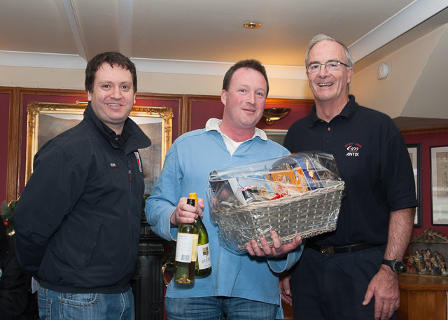 Colman Garvey receiving his prize from Sponsor Anthony O'Leary watched by Rear Admiral Keelboats, Ronan Enright. Picture Robert Bateman