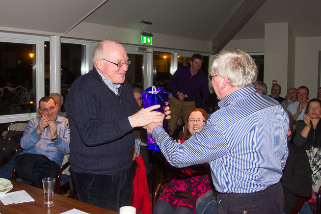 Michael Murphy of SCORA  presenting Denis Kiely with a 25 year old bottle of port marking his retirement as  National Handicapper.
