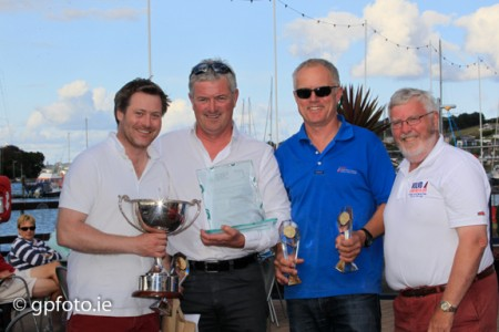 Winner overall, Stefan Hyde, Jerry Dowling and Jimmy Dowling receiving their trophy from Admiral Pat Lyons.