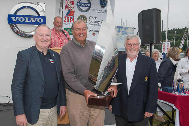 L.to R Adrian Yeates, MD VolvoCar Ireland Ltd., Richard Matthews receiving his trophy from Admiral Pat Lyons. Picture Robert Bateman