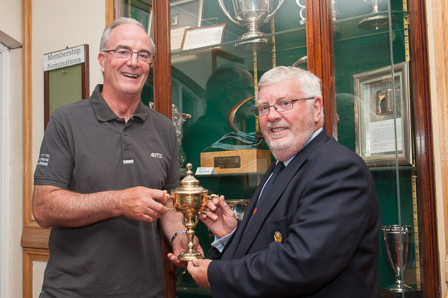 Irish Team Captain, Anthony O'Leary,  presenting the Commodores' Cup to Royal Cork Admiral Pat Lyons. Photograph Robert Bateman
