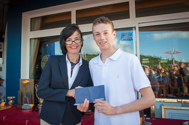 Rear Admiral Dinghies Celine McGrath, making a presentation to Adam D'Arcy in recognition of his Silver Medal win at the International Topper Class World Championships, Pic Robert Bateman
