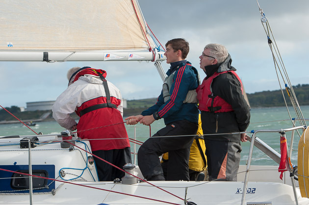LIke father like son, Tom Crosbie and son Patrick concentrating on their sailing. Picture Robert Bateman