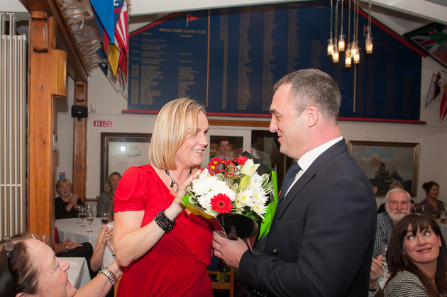 Rear Admiral Kieran Keelboats presenting his wife, Joanne, with a bouquet of floweers. Pic Robert Bateman
