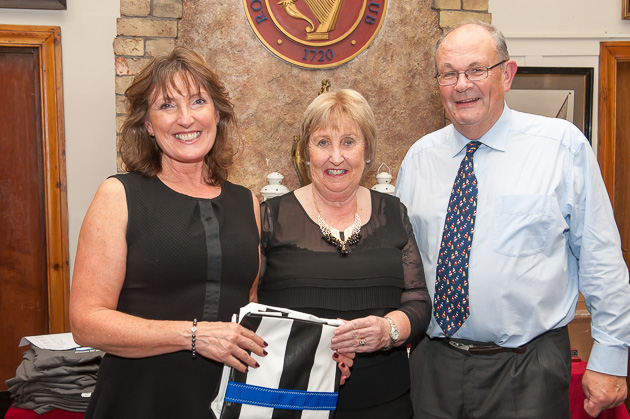 Wendy McEllligott receiving her prize for the May League. L. to R. Wendy McElligott, Lay Admiral Ann Lyons and Des McWilliam Sponsor. Pic Robert Bateman