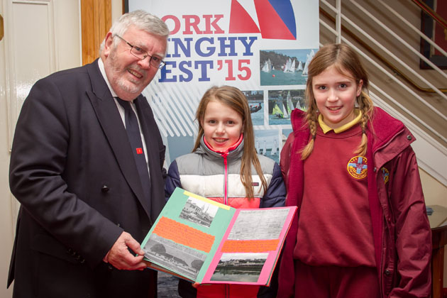 Admiral Pat Lyons with Eva Spillane and  Zara Casey with their entry for the Cork Schools History Project. Picture Robert Bateman