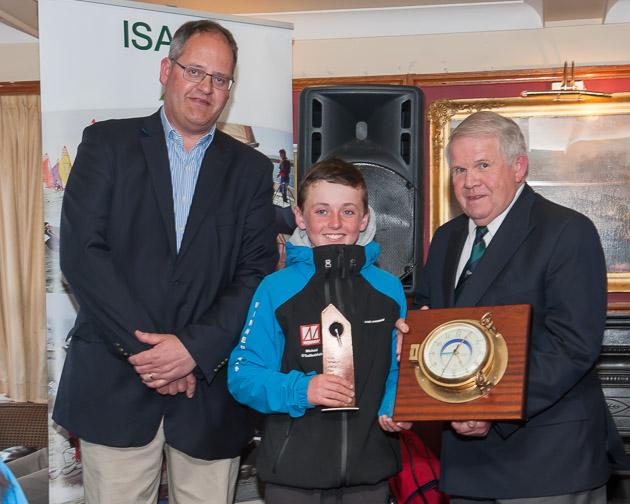 IODAI President, Aidan Staunton, overall Optimist Trials Winner Micháel Ó Suilleabháin KYC and ISA President David Lovegrove. Picture Robert Bateman