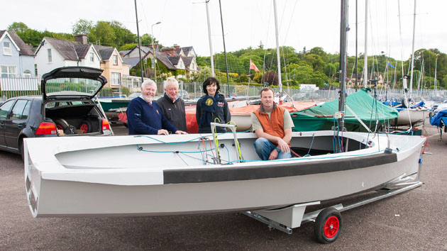 All smiles to greet Colin Chapman's new Ultra Design National 18 one of the first eight National 18's new design to arrive at the Royal Cork Yacht Club for the 2015 season. L. to R. Royal Cork Admiral Pat Lyons, Dom Long, President National 18 Class, Rear Admiral Dinghies, Celine McGrath and owner Colin Chapman. Picture Robert Bateman.