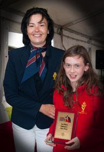 Ciara Burns Winner of the Optimist Fun Fleet prize with Rear Admiral Dinghies Celine McGrath. Pic Robert Bateman