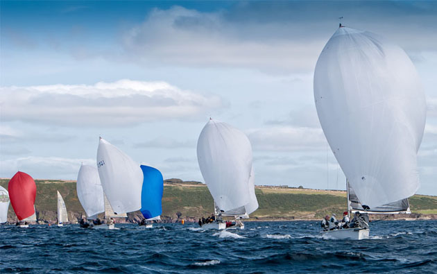 The fleet on a downwind leg during Race 9 of the 1720 European Championships. Pic Robert Bateman