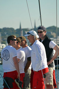 Team Captain Anthony O'Leary shares a lightmoment with crew members between races.