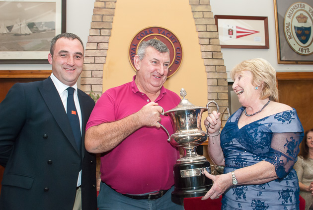 A light hearted moment as Martin Darrer accepts the Breffni McGovern Trophy from the Lady Admiral watched by Kieran O'Connell, Rear Admiral Keelboats. Picture Robert Bateman