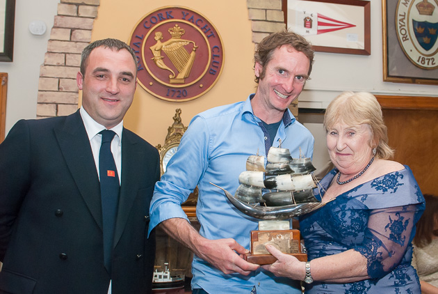 Dave Lane,YaGottaWanna, receiving the Bayona Trophy from the Lady Admiral watched by Rear Admiral Keelboats, Kierann O'Connell.