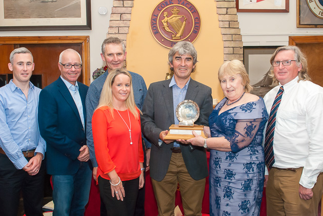 Conor Phelan and the crew of Jump Juice receiving the Boat of the Year trophy from the Lady Admiral. Picture Robert Bateman