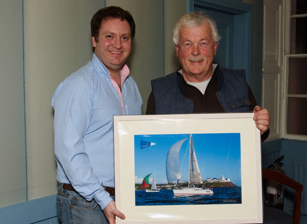If you fancy racing happiness is in winning.!! Pictured here SCORA Commodore Ronan Enright presenting Former Admiral Peter Deasy with his first prize in Class 2 IRC for SCORA 2015. Pic Robert Bateman
