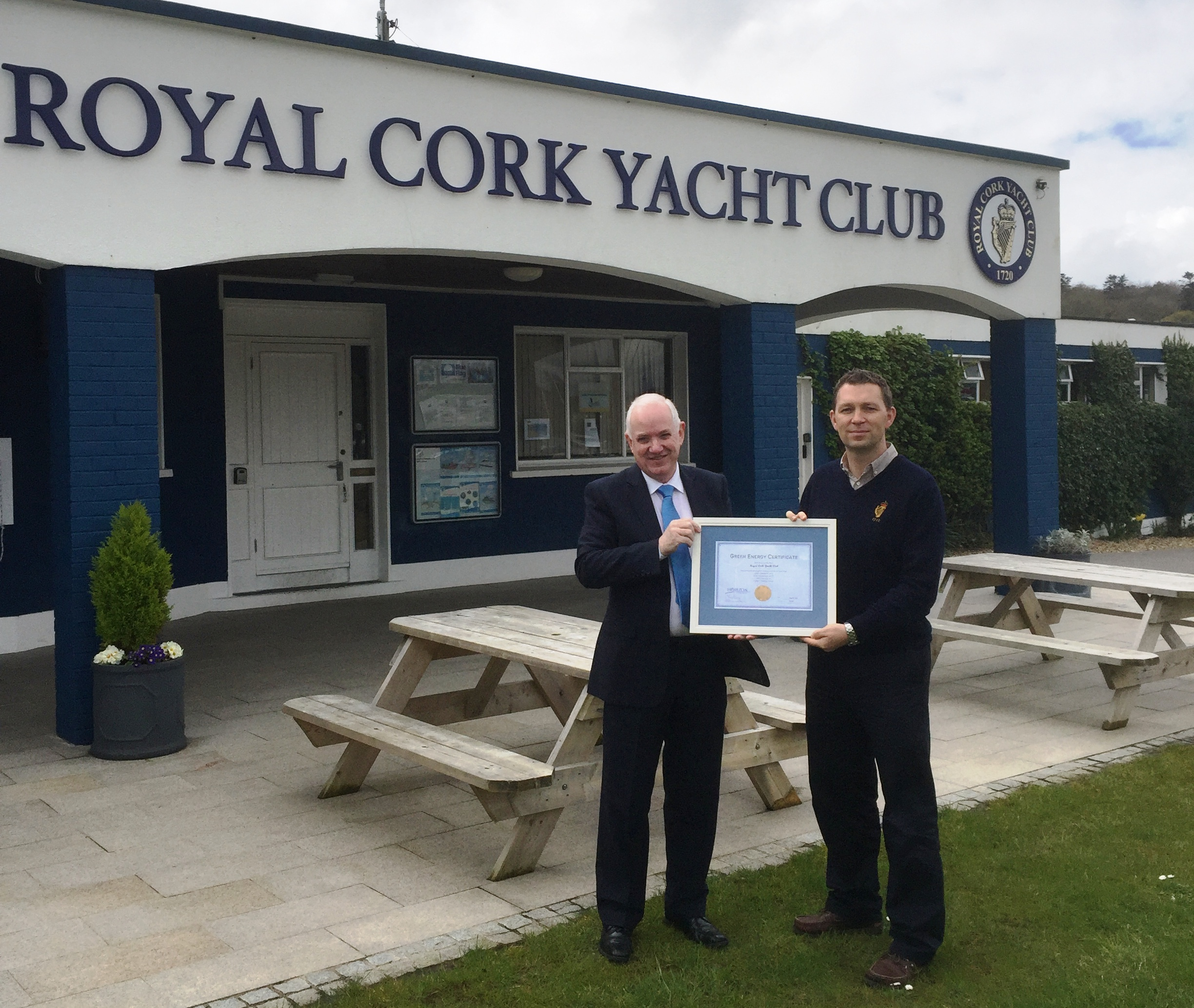 Gavin Deane, General Manager, Royal Cork YC accepting the Green Energy Certificate from Dermot Cullen, Inside Sales Director,  HEG