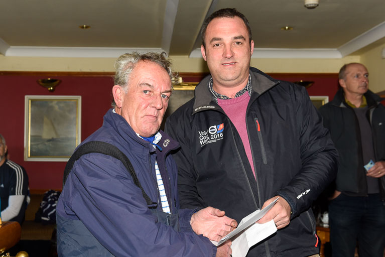 Leonard Donnery receives his prize for winning today's race in Echo Overall from Kieran O' Connell Rear Admiral Keelboats