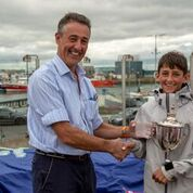Tim Lucas, President IODAI presenting Justin Lucas with the Senior Gold Fleet Trophy