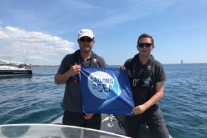 Kieran O'Connell, Event Chairman Volvo Cork Week 2018 & Gavin Deane, General Manager, Royal Cork Yacht Club displaying the Sailors for the Sea flag at Volvo Cork Week 2018