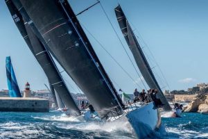 Tacks-free zone……the R-P/Marteen 72 Aragon leads the Rolex Middle Sea Race start out of Valetta Harbour with Nin O'Leary on the helm in an exemplary tacking-free exit